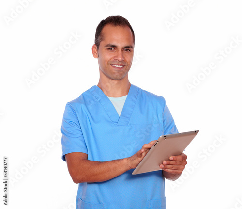 Young male in nurse uniform using tablet pc