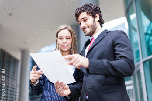 Business people reading a document