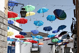 Fototapety Évora, Portugal umbrella different colors