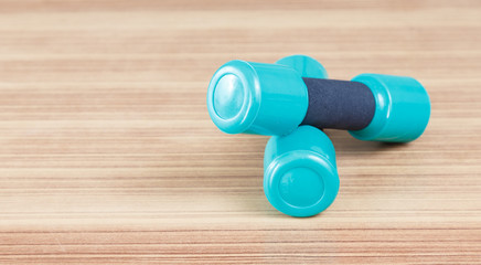 samall Fitness dumbbells  on the desk wooden