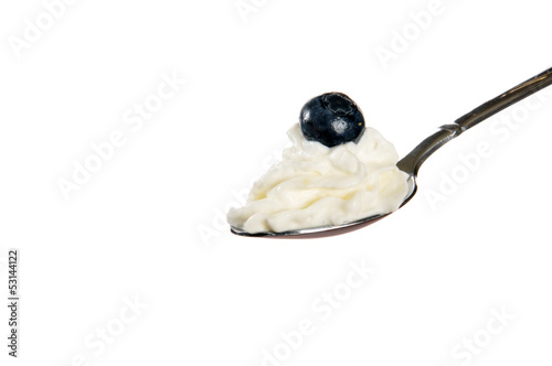 Whipped cream with a blueberry