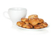 Various cookies in bowl and tea cup