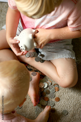 Little Boys Breaking into Piggy Bank