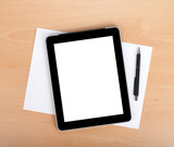 Tablet with blank screen over white papers