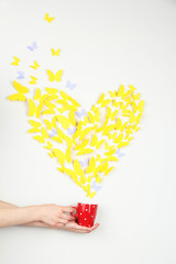 Paper yellow butterfly in form of heart fly out cup