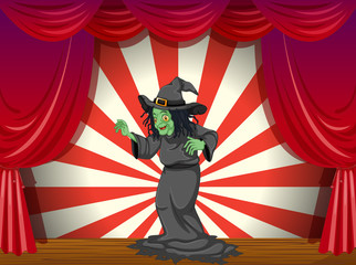 A witch standing at the stage