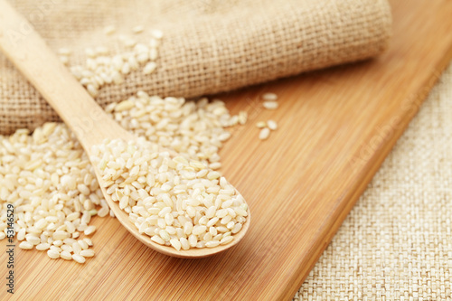 Uncooked rice on spoon