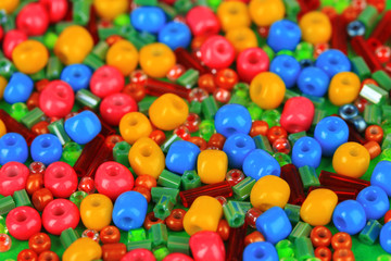 Different colorful beads close-up