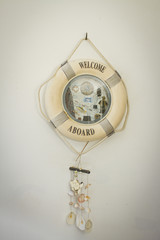 decor lifebuoy, white lifebuoy decorated with sea shells