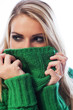 Woman hiding her face with her sweater collar