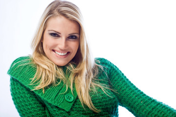 Portrait of a blond woman smiling at camera