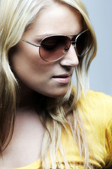 Close-up portrait of blond woman with sunglasses