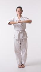 Woman in kimono going for greeting on white