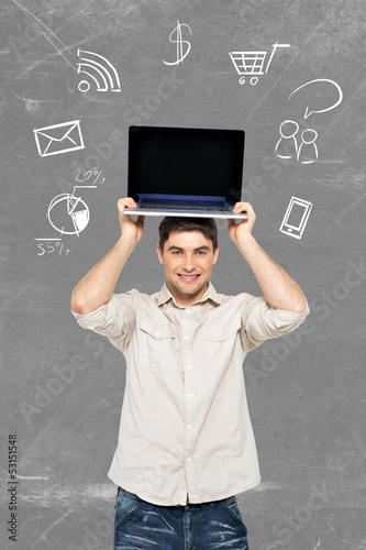 man with laptop and icons around computer