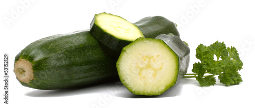 Cut fresh vegetable zucchini isolated on white background