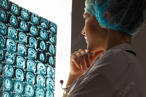 Woman doctor examining x-ray
