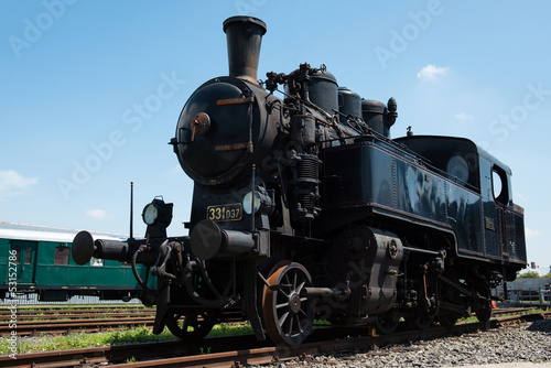 Vintage steam locomotive in station