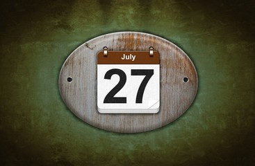 Old wooden calendar with July 27.