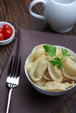 Steamed meat dumplings, traditional pelmeni or varenyky dish