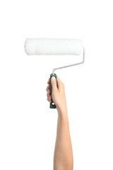 Woman hand holding a paint roller