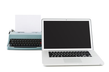 contemporary laptop in front of an old typewriter