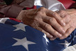 Hands holding an American flag - 53155566