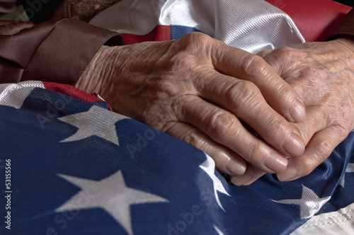 Leinwandbild Motiv Hands holding an American flag