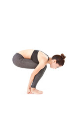 woman making a Yoga pose: Hands to Feet Pose – Pada Hasthasana