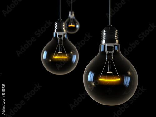 three glowing lights on  black background