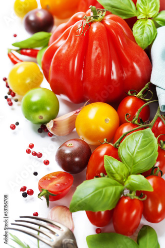 fresh tomatoes and herbs - healthy eating concept