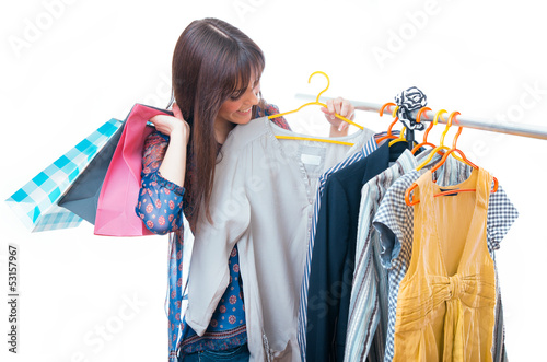 Young woman choosing clothes in a boutique