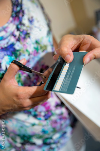 cutting a credit card with scissors