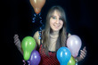 smiling girl with colorful balloons