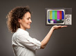 woman holding a television