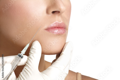 Fototapeta beauty woman close up injecting cosmetic treatment