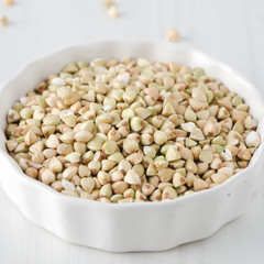 green buckwheat in a white bowl