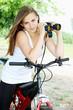 woman on bicycle with binoculars