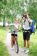 pair of binoculars and bike