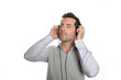 Man relaxing with headset and music player
