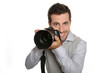Portrait of photographer holding digital camera