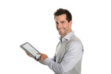 Startup businessman showing tablet screen poster
