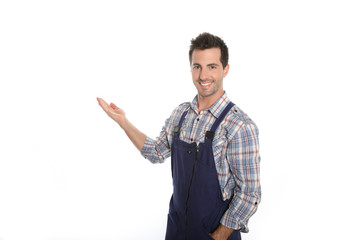 Cheerful craftsman pointing at message on whiteboard