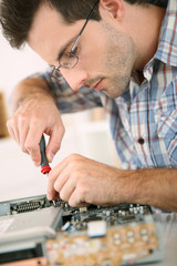 Man fixing electronic appliance