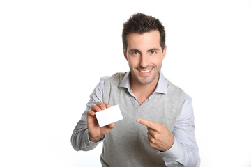 Handsome smiling man showing card
