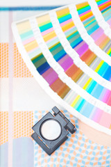 Printing concept,palette with loupe and printed material