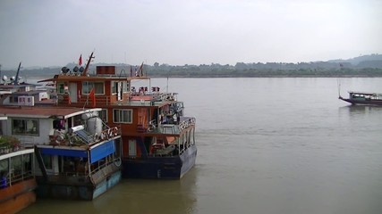 Mekong Freighter boats waiting to load cargo