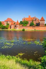 Malbork castle in summer scenery, Poland