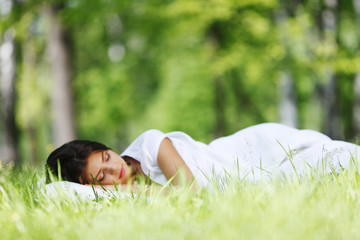 Woman sleeping on grass