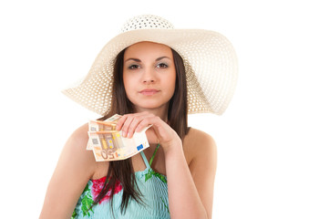 beautiful woman in summer dress with hat and money