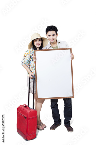 Asian couple hold blank board on white